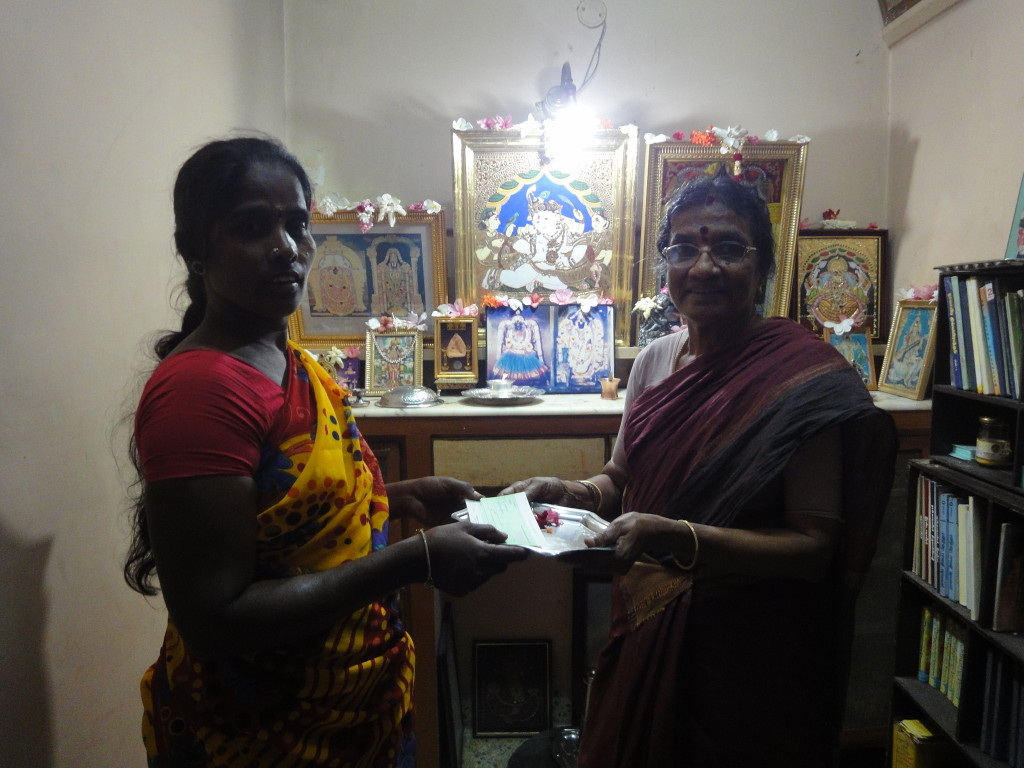 Mother of trustee, on behalf of Sriram Charitable Trust, donated educational aid to Jayalakshmi's (a housekeeping staff) children's college annual fees.