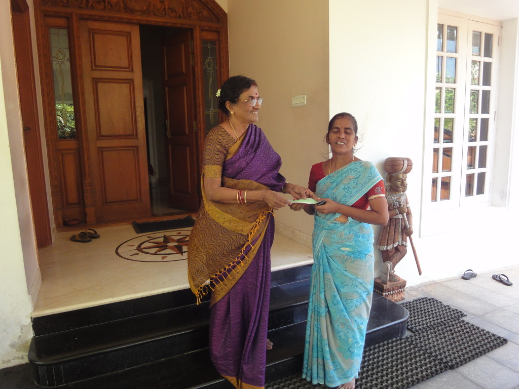Mother of trustee, on behalf of Sriram Charitable Trust, provided educational aid to Sumathi's (a hospital assistant) children's school annual fees.