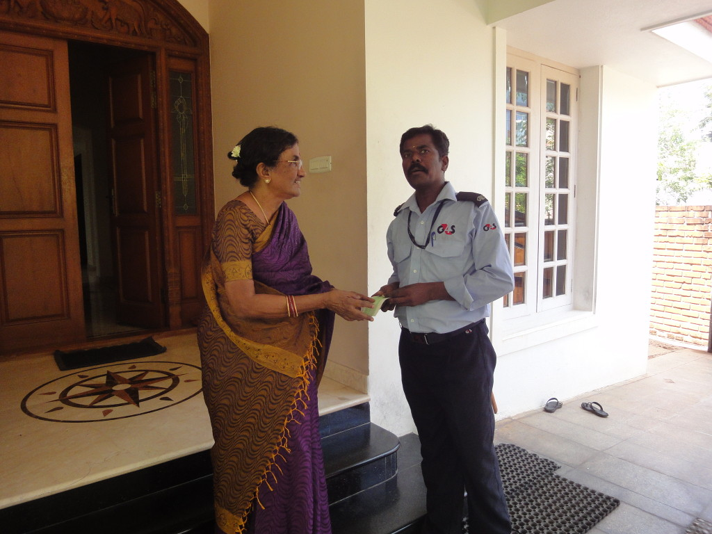 Mother of trustee, on behalf of Sriram Charitable Trust, provided educational aid to Sathish's (a security guard by profession) children's school annual fees.
