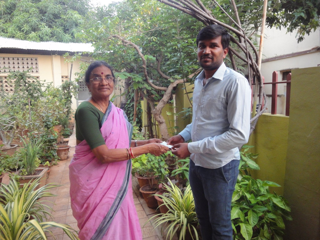 Parent of the trustee handed over an educational-aid cheque for higher studies of a housemaid's son