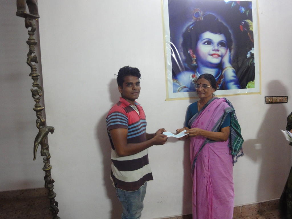 The parents of Trustee had handed over an educational aid cheque to Barath for his B.Sc. second-year studies.