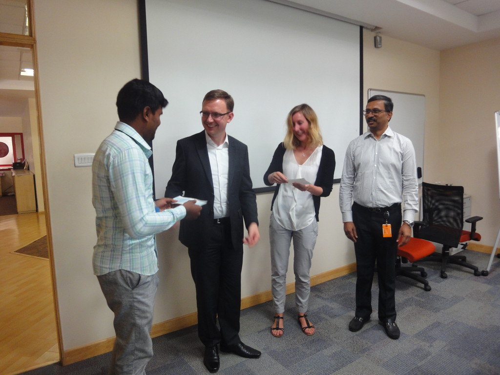 Eike Wannick, Team Manager Purchasing, and Kevin Goethling, Senior Manager Content Management (Books & Journals), handed over an educational-aid cheque to Shanmugam studying in B.Ed second year.